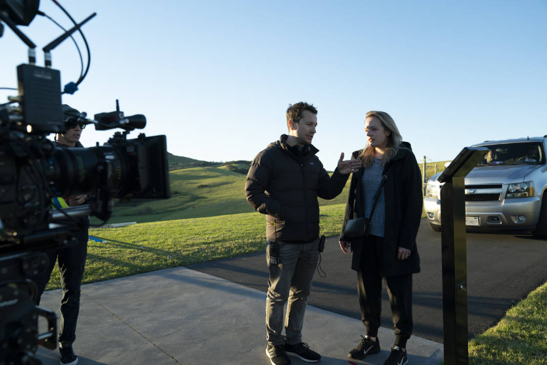 (from left) Writer/director Leigh Whannell and Elisabeth Moss on the set of The Invisible Man.