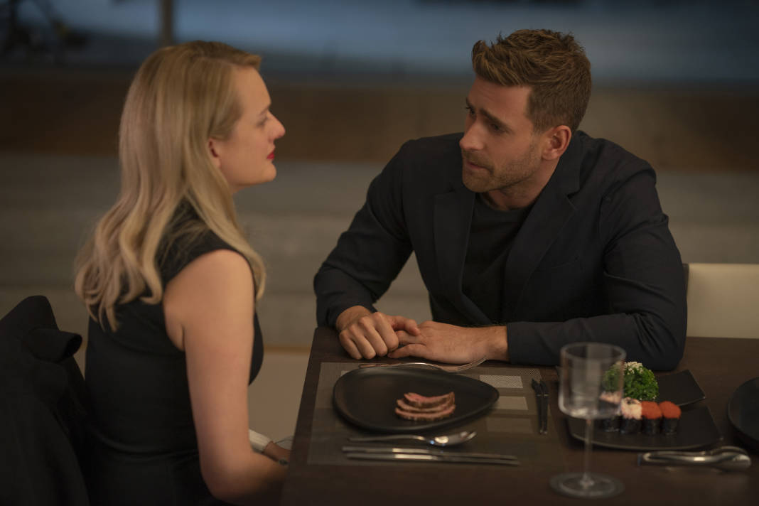 (from left) Cecilia Kass (Elisabeth Moss, back to camera) and Adrian Griffin (Oliver Jackson-Cohen) in The Invisible Man, written and directed by Leigh Whannell.